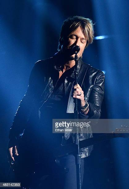 Singer/songwriter Keith Urban performs onstage during the 49th Annual Academy of Country Music Awards at the MGM Grand Garden Arena on April 6 2014...