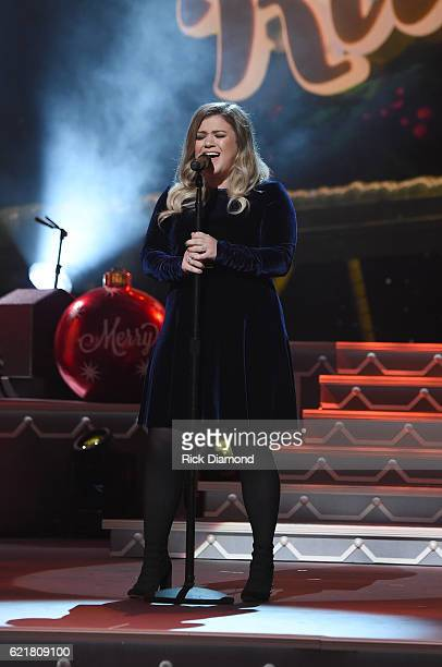 Singersongwriter Kelly Clarkson performs on stage during the CMA 2016 Country Christmas on November 8 2016 in Nashville Tennessee