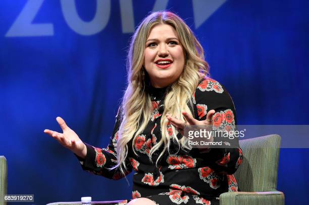 Singersongwriter Kelly Clarkson speaks on the the Featured Presentation Music's Leading Ladies Speak Out panel powered by Nielsen Music during Music...