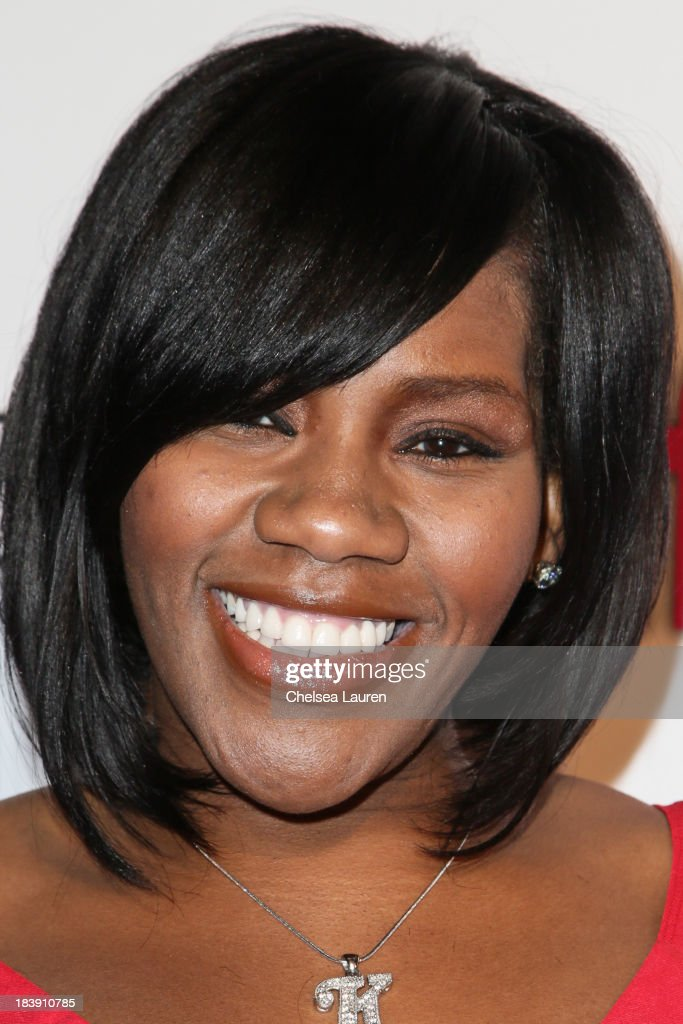 Singer/songwriter Kelly Price arrives at Life & Style's Hollywood in Bright Pink event hosted by Giuliana Rancic at Bagatelle on October 9, 2013 in Los Angeles, California.
