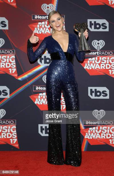 Singersongwriter Kelsea Ballerini winner of the Best New Country Artist award poses in the press room at the 2017 iHeartRadio Music Awards which...