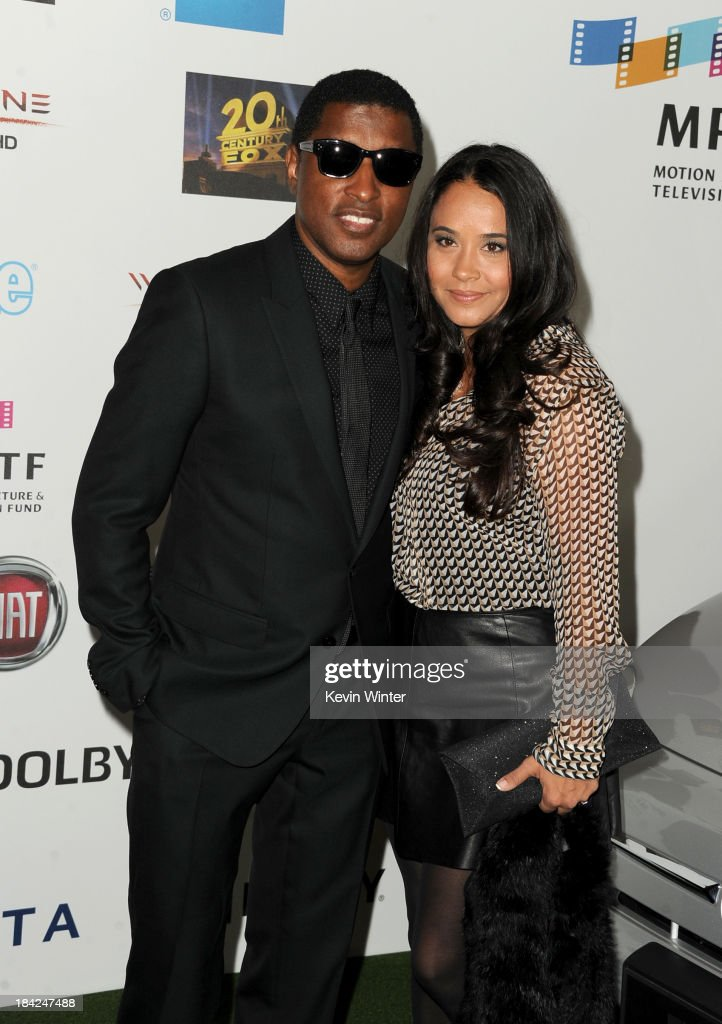 Singer-songwriter Kenneth '<a gi-track='captionPersonalityLinkClicked' href=/galleries/search?phrase=Babyface&family=editorial&specificpeople=227435 ng-click='$event.stopPropagation()'>Babyface</a>' Edmonds and Nicole Pantenburg attend 'Hugh Jackman... One Night Only' Benefiting MPTF at Dolby Theatre on October 12, 2013 in Hollywood, California.