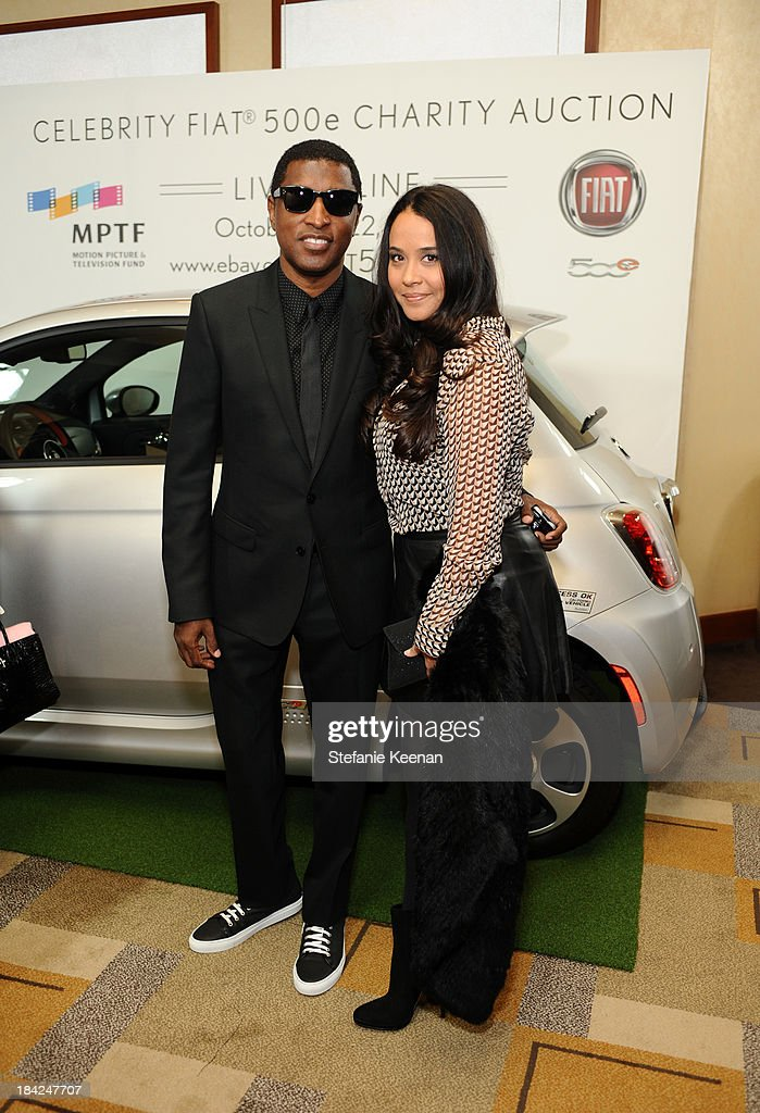 Singer-songwriter Kenneth 'Babyface' Edmonds (L) and Nicole Pantenburg attend 'Hugh Jackman... One Night Only' Benefiting MPTF at Dolby Theatre on October 12, 2013 in Hollywood, California.