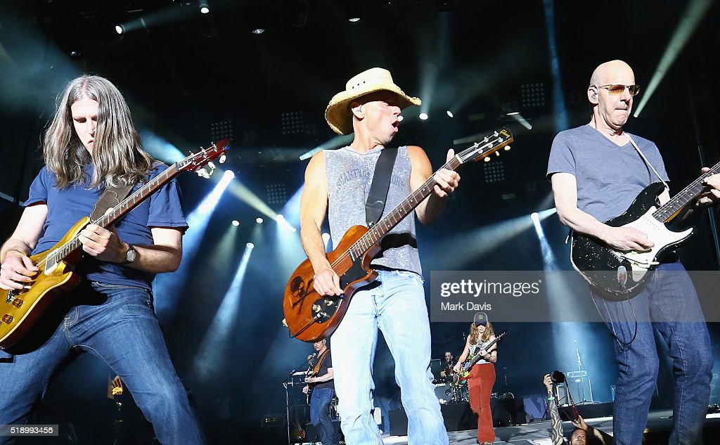 Singer-songwriter Kenny Chesney (C) and guitarist Kenny Greenberg (R) perform onstage during the 4th ACM Party For A Cause Festival at the Las Vegas Festival Grounds on April 3, 2016 in Las Vegas, Nevada.