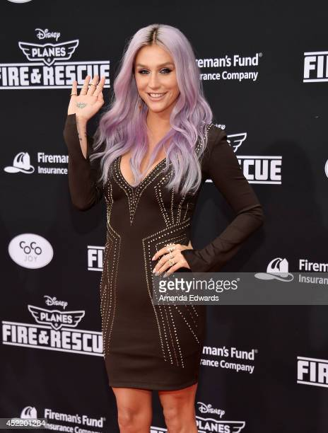 Singersongwriter Kesha arrives at the Los Angeles premiere of Disney's 'Planes Fire Rescue' at the El Capitan Theatre on July 15 2014 in Hollywood...