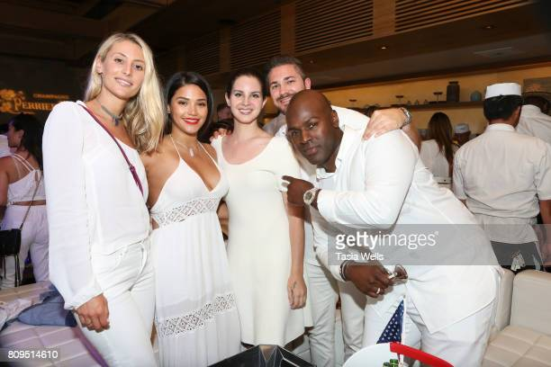 Singersongwriter Lana del Ray John Ehmann of Interscope Records and television personality Corey Gamble at the 4th annual 'Red White and Bootsy' July...