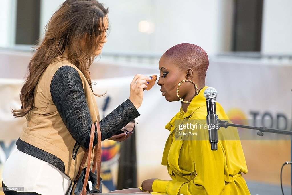 Singer-Songwriter <a gi-track='captionPersonalityLinkClicked' href=/galleries/search?phrase=Laura+Mvula&family=editorial&specificpeople=10006726 ng-click='$event.stopPropagation()'>Laura Mvula</a> (R) gets prepared to perform on NBC's 'Today' at NBC's TODAY Show on September 4, 2013 in New York City.