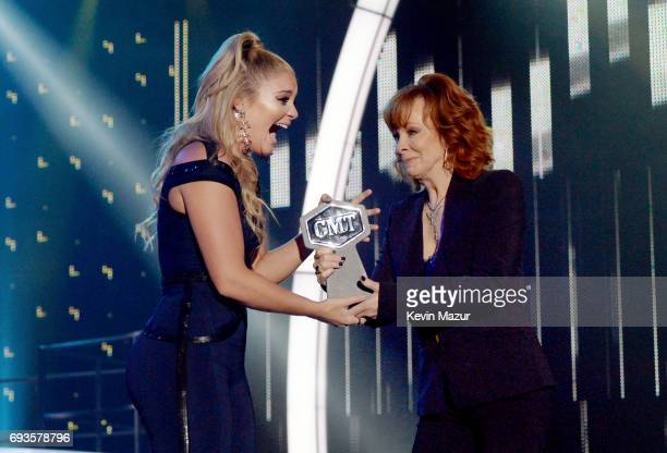 Singersongwriter Lauren Alaina accepts an award onstage from Reba McEntire at the 2017 CMT Music Awards at the Music City Center on June 7 2017 in...