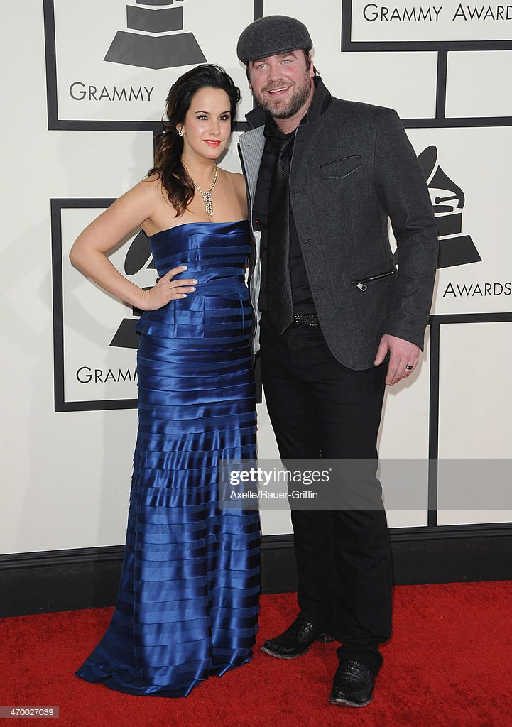 Singer-songwriter Lee Brice (R) and Sarah Reevely arrive at the 56th GRAMMY Awards at Staples Center on January 26, 2014 in Los Angeles, California.