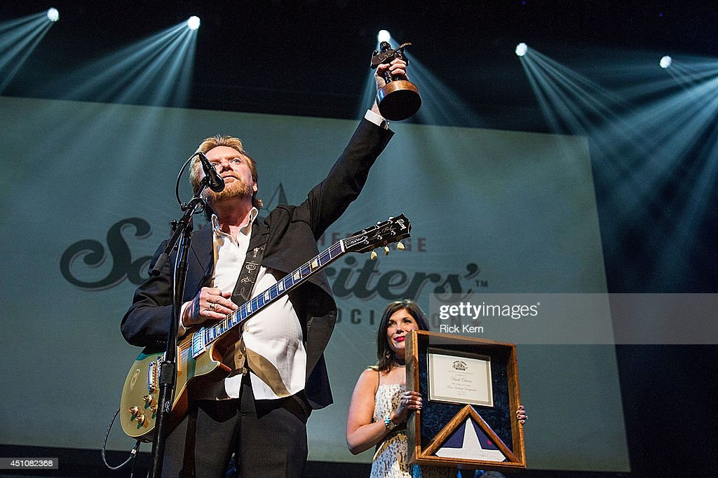 Singer-songwriter Lee Roy Parnell receives the Willie Nelson award on behalf of the late Buck Owens during the 9th Annual Texas Heritage Songwriters' Hall of Fame Awards Show at ACL Live on June 22, 2014 in Austin, Texas.