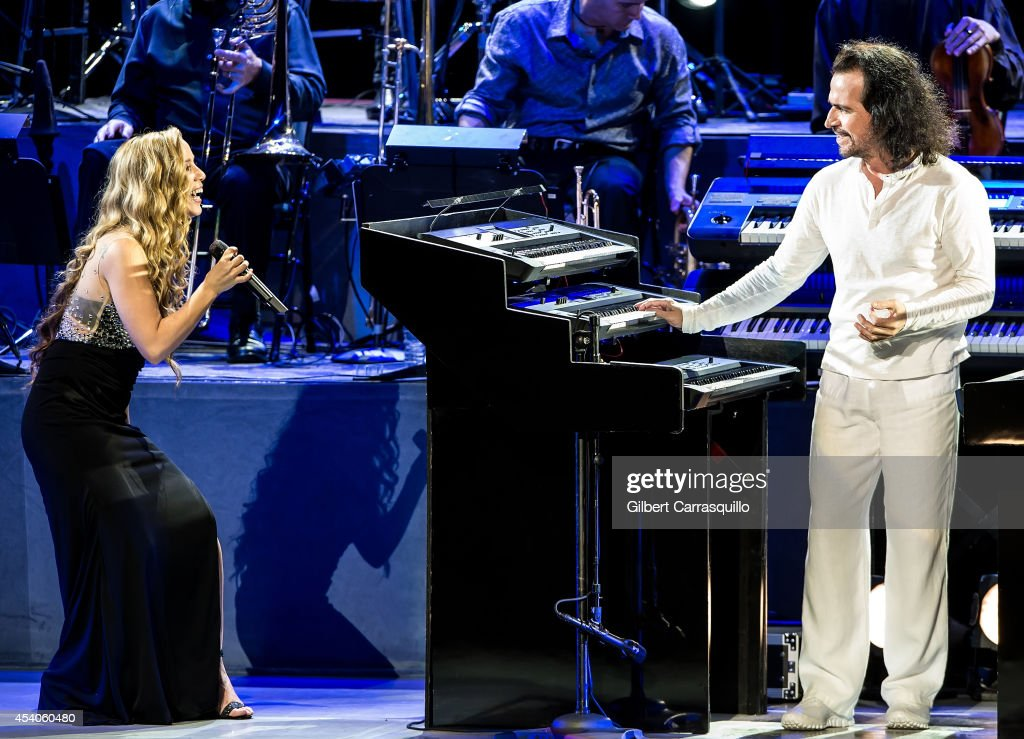 Singer/songwriter Lisa Lavie and pianist, keyboardist, composer, and music producer Yanni performs during Yanni World Tour 2014 at Mann Center For Performing Arts on August 23, 2014 in Philadelphia, Pennsylvania.