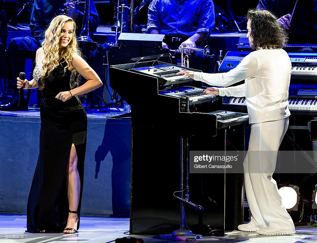 Singer/songwriter Lisa Lavie and pianist, keyboardist, composer, and music producer <a gi-track='captionPersonalityLinkClicked' href=/galleries/search?phrase=Yanni&family=editorial&specificpeople=627763 ng-click='$event.stopPropagation()'>Yanni</a> performs during <a gi-track='captionPersonalityLinkClicked' href=/galleries/search?phrase=Yanni&family=editorial&specificpeople=627763 ng-click='$event.stopPropagation()'>Yanni</a> World Tour 2014 at Mann Center For Performing Arts on August 23, 2014 in Philadelphia, Pennsylvania.