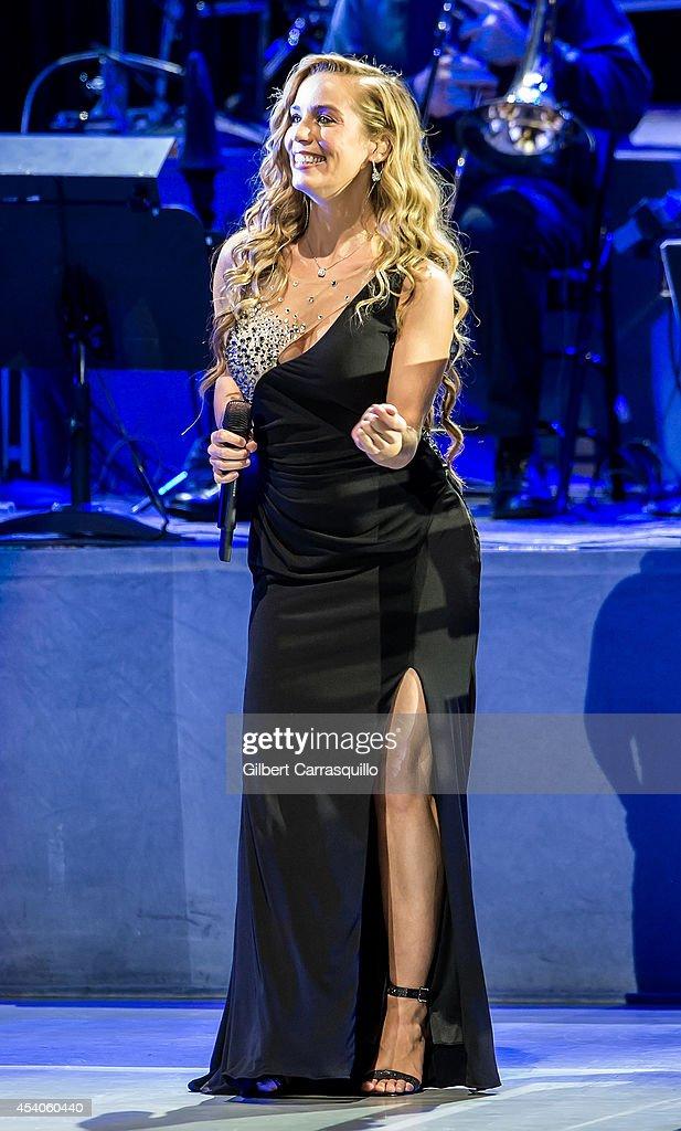 Singer/songwriter Lisa Lavie performs during Yanni World Tour 2014 at Mann Center For Performing Arts on August 23, 2014 in Philadelphia, Pennsylvania.