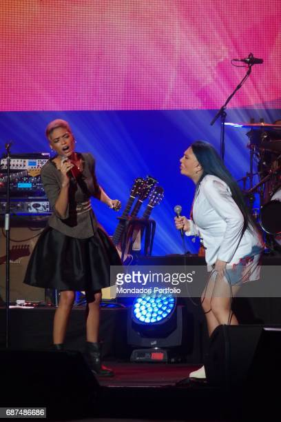 Singersongwriter Loredana BertŠ and singer Elodie performing during Amiche in Arena a concert against femicide and violence against women conceived...