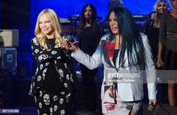Singersongwriter Loredana BertŠ and singer Patty Pravo performing during Amiche in Arena a concert against femicide and violence against women...
