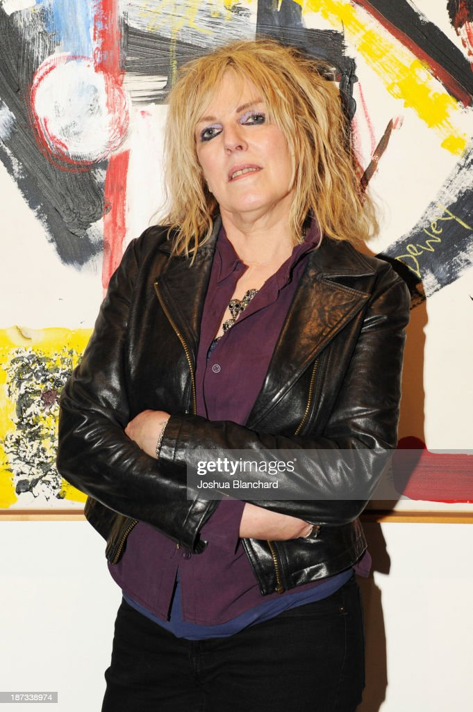 Singer/songwriter Lucinda Williams arrives at Mr. Musichead Gallery for the 'Miles Davis: The Collected Artwork' Launch Party on November 7, 2013 in Los Angeles, California.