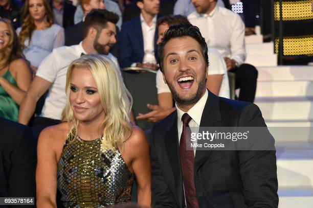 Singersongwriter Luke Bryan and Caroline Boyer watch the 2017 CMT Music awards at the Music City Center on June 7 2017 in Nashville Tennessee