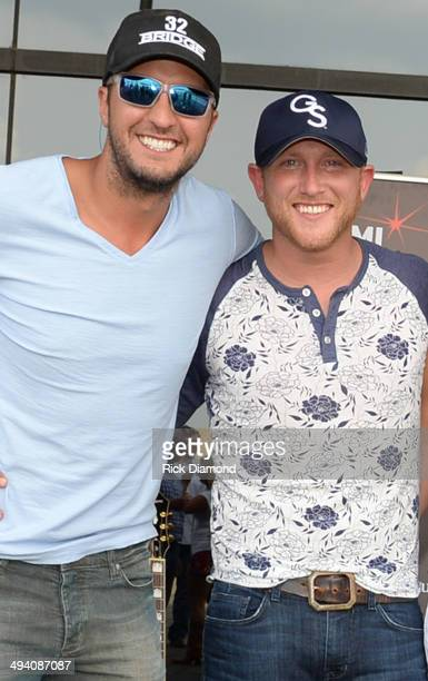 Singer/Songwriter Luke Bryan helps celebrate Singer/Songwriter Cole Swindell's First No1 Song 'Chillin' It' at BMI Nashville on May 27 2014 in...