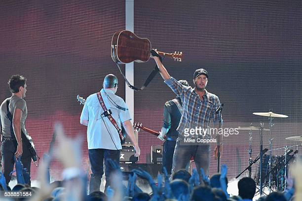 Singersongwriter Luke Bryan performs onstage during the 2016 CMT Music awards at the Bridgestone Arena on June 8 2016 in Nashville Tennessee