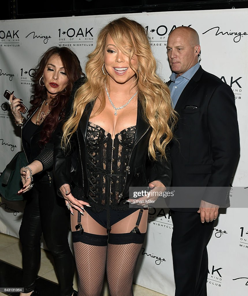Singer/songwriter <a gi-track='captionPersonalityLinkClicked' href=/galleries/search?phrase=Mariah+Carey&family=editorial&specificpeople=171647 ng-click='$event.stopPropagation()'>Mariah Carey</a> (C) arrives at 1 OAK Nightclub at the Mirage Hotel & Casino to debut her DJ set on June 26, 2016 in Las Vegas, Nevada.