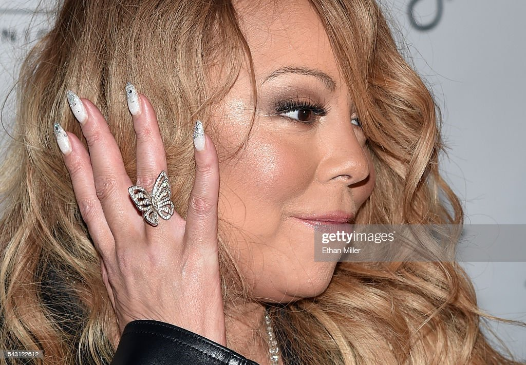 Singer/songwriter <a gi-track='captionPersonalityLinkClicked' href=/galleries/search?phrase=Mariah+Carey&family=editorial&specificpeople=171647 ng-click='$event.stopPropagation()'>Mariah Carey</a> is interviewed as she arrives at 1 OAK Nightclub at the Mirage Hotel & Casino to debut her DJ set on June 26, 2016 in Las Vegas, Nevada.