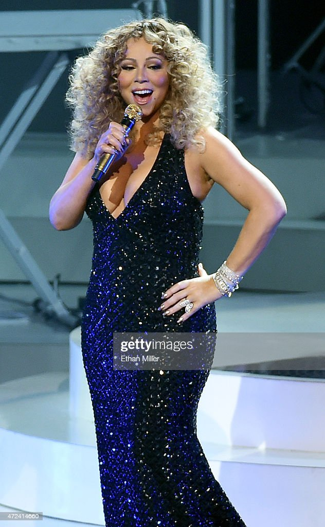 Singer/songwriter <a gi-track='captionPersonalityLinkClicked' href=/galleries/search?phrase=Mariah+Carey&family=editorial&specificpeople=171647 ng-click='$event.stopPropagation()'>Mariah Carey</a> performs during the launch of her residency 'MARIAH #1 TO INFINITY' at The Colosseum at Caesars Palace on May 6, 2015 in Las Vegas, Nevada.