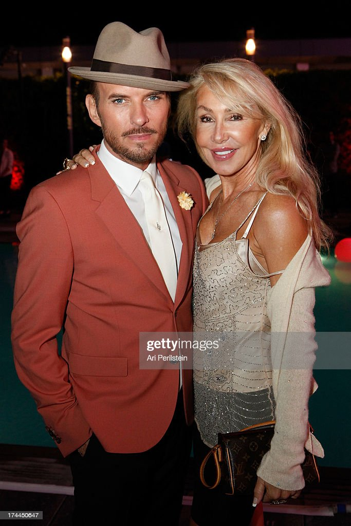 Singer/Songwriter Matt Goss and <a gi-track='captionPersonalityLinkClicked' href=/galleries/search?phrase=Linda+Thompson+-+Actress&family=editorial&specificpeople=13681123 ng-click='$event.stopPropagation()'>Linda Thompson</a> attend Los Angeles Confidential Magazine Celebrates With Cover Star Sean Combs Summer Issue Party Honors LA's Business Titans at JW Marriott Los Angeles at L.A. LIVE on July 25, 2013 in Los Angeles, California.