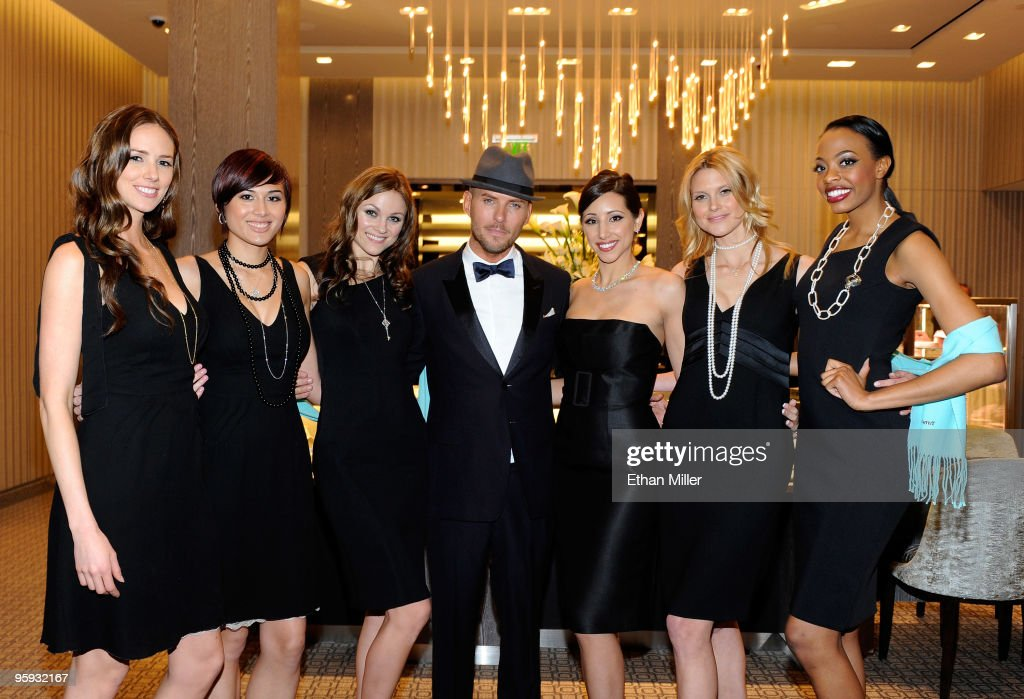 Singer/songwriter Matt Goss poses with models after performing during a grand opening cocktail party at the Tiffany Co store at Crystals at...