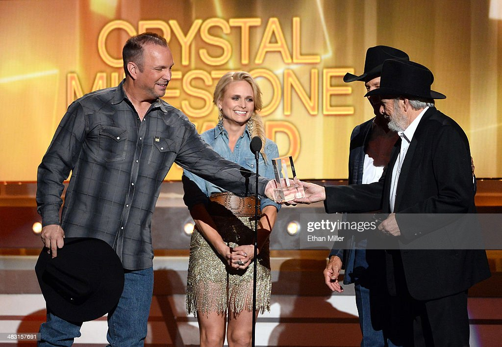 Singer/songwriter <a gi-track='captionPersonalityLinkClicked' href=/galleries/search?phrase=Merle+Haggard&family=editorial&specificpeople=603099 ng-click='$event.stopPropagation()'>Merle Haggard</a> (R) accepts the ACM Crystal Milestone Award from (L-R) recording artists <a gi-track='captionPersonalityLinkClicked' href=/galleries/search?phrase=Garth+Brooks&family=editorial&specificpeople=206288 ng-click='$event.stopPropagation()'>Garth Brooks</a>, <a gi-track='captionPersonalityLinkClicked' href=/galleries/search?phrase=Miranda+Lambert&family=editorial&specificpeople=571972 ng-click='$event.stopPropagation()'>Miranda Lambert</a> and <a gi-track='captionPersonalityLinkClicked' href=/galleries/search?phrase=George+Strait&family=editorial&specificpeople=234588 ng-click='$event.stopPropagation()'>George Strait</a> onstage during the 49th Annual Academy of Country Music Awards at the MGM Grand Garden Arena on April 6, 2014 in Las Vegas, Nevada.