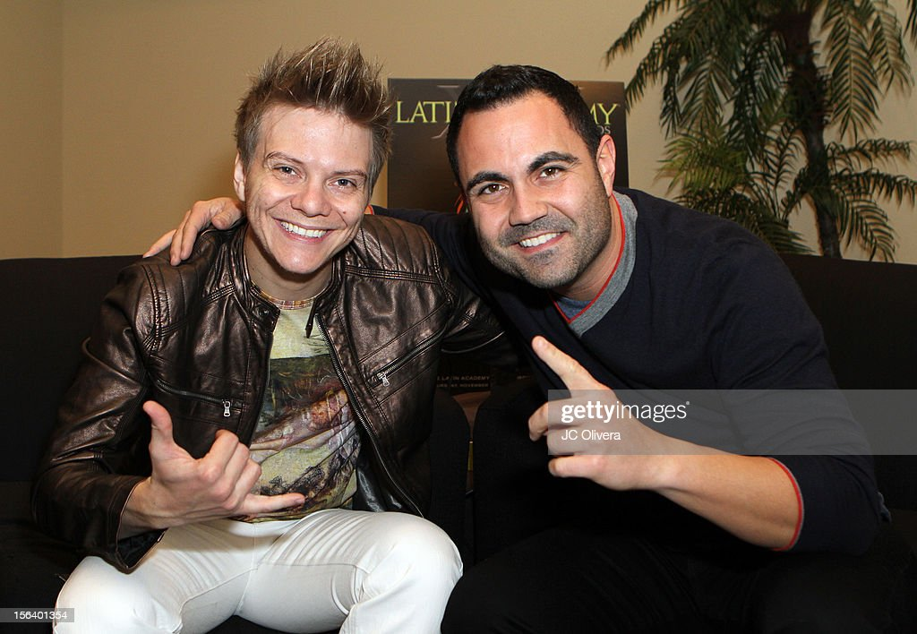 Singer/songwriter Michel Telo (L) and radio personality Enrique Santos attend the 13th annual Latin GRAMMY Awards Univision Radio Remotes held at the Mandalay Bay Events Center on November 14, 2012 in Las Vegas, Nevada.