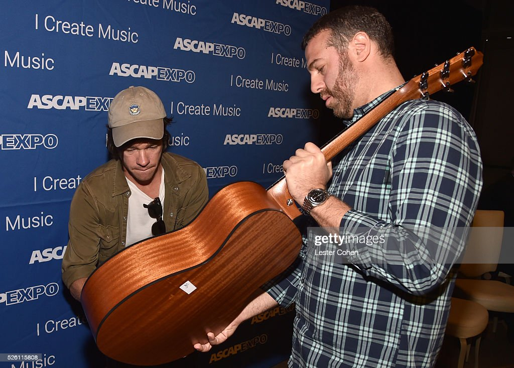 Singer-songwriter Nate Ruess (L), with ASCAP Sr. Director, Pop/Rock, Membership Jason Silberman, signs a #StandWithSongwriters guitar, which will be presented in May to members of Congress to urge them to support reform of outdated music licensing laws, during the 2016 ASCAP 'I Create Music' EXPO on April 29, 2016 in Los Angeles, California.