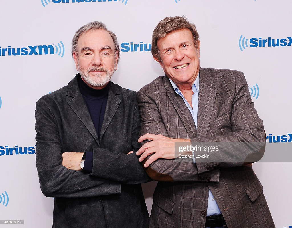 Singer/songwriter Neil Diamond and host Bruce 'Cousin Brucie' Morrow attend SiriusXM's 'Town Hall' with Neil Diamond hosted by Cousin Brucie On SiriusXM's Neil Diamond Radio at SiriusXM Studios on October 21, 2014 in New York City.