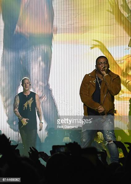 Singer/Songwriter Nelly joins Tyler Hubbard of Florida Georgia Line at FLG's Dig Your Roots 2016 Tour at Bridgestone Arena on October 13 2016 in...