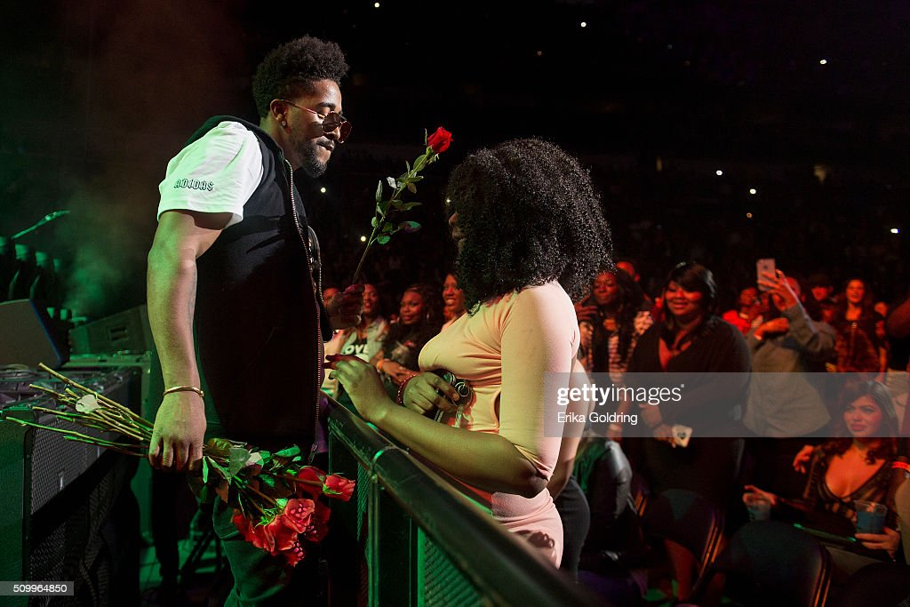 Singersongwriter Omarion hands a fan a rose during his performance at Smoothie King Center on February 12 2016 in New Orleans Louisiana