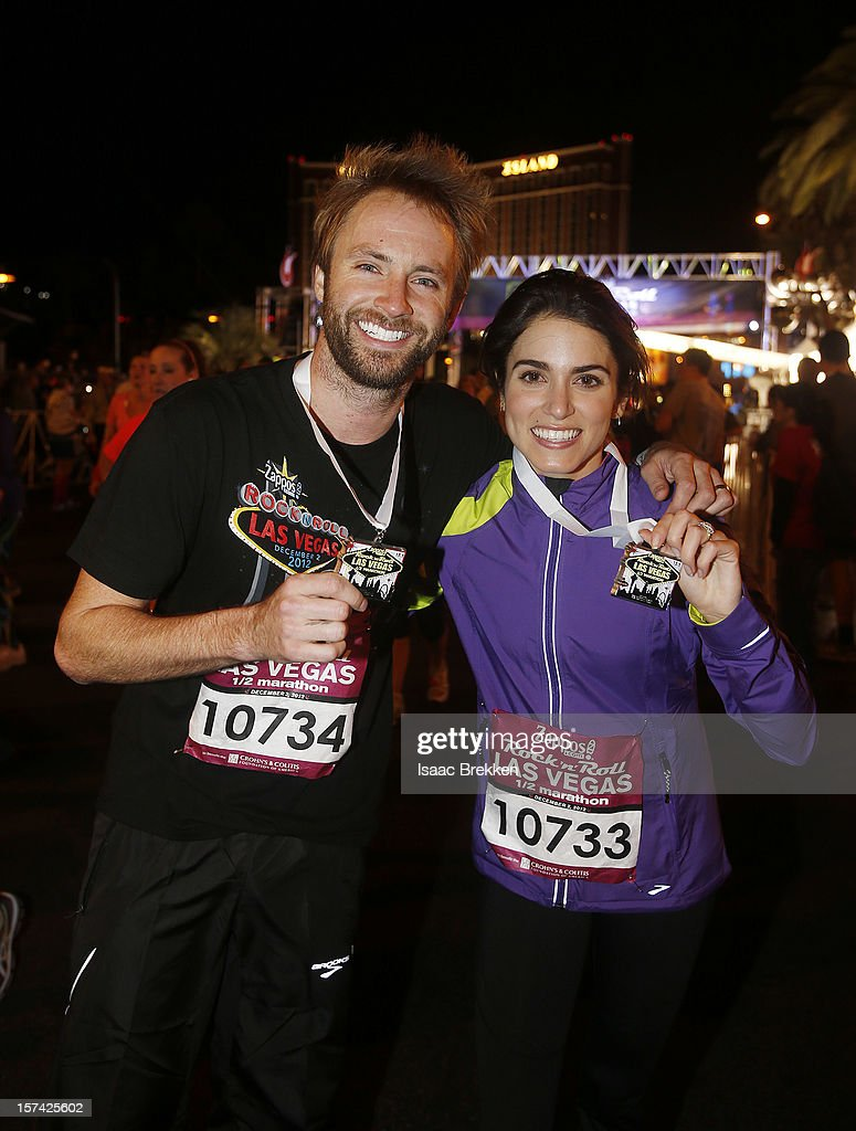 Singer/songwriter Paul McDonald (L) and actress Nikki Reed pose after finishing a half-marathon race on the Las Vegas Strip during the Zappos.com Rock 'n' Roll Las Vegas Marathon & Half-Marathon on December 2, 2012 in Las Vegas, Nevada.