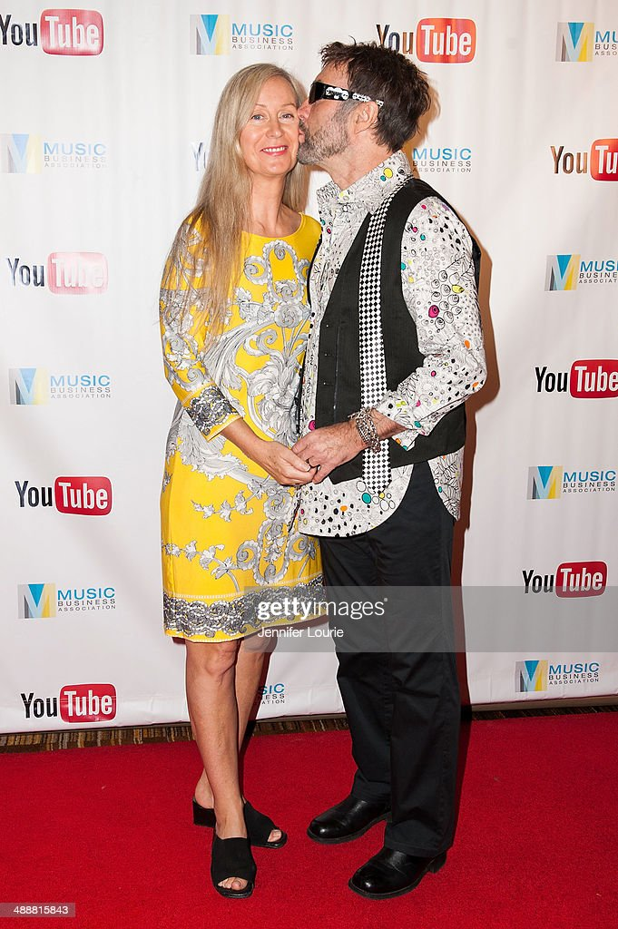 Singer-songwriter Paul Rodgers and wife Cynthia Kereluk Rodgers attend the Music Biz 2014 Awards at the Hyatt Regency Century Plaza on May 8, 2014 in Century City, California.