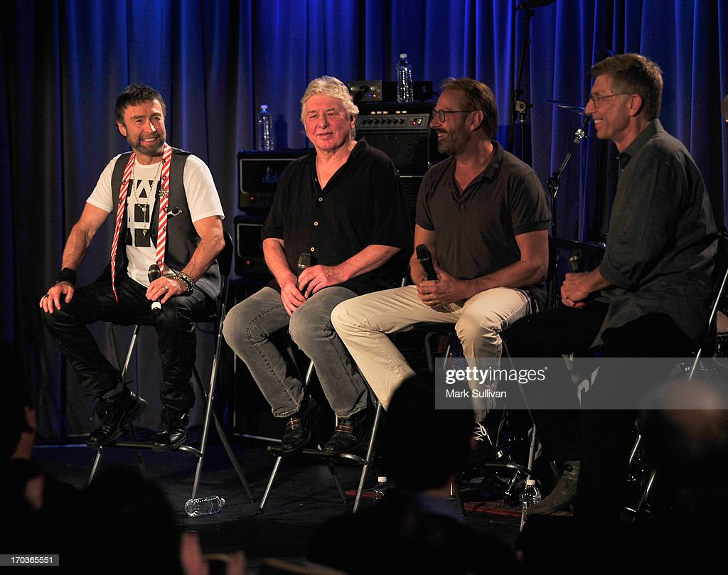 Singer/songwriter Paul Rodgers, guitarist/songwriter Mick Ralphs, drummer Simon Kirke and GRAMMY Museum executive director Bob Santelli onstage during An Evening With Bad Company at The GRAMMY Museum on June 11, 2013 in Los Angeles, California.