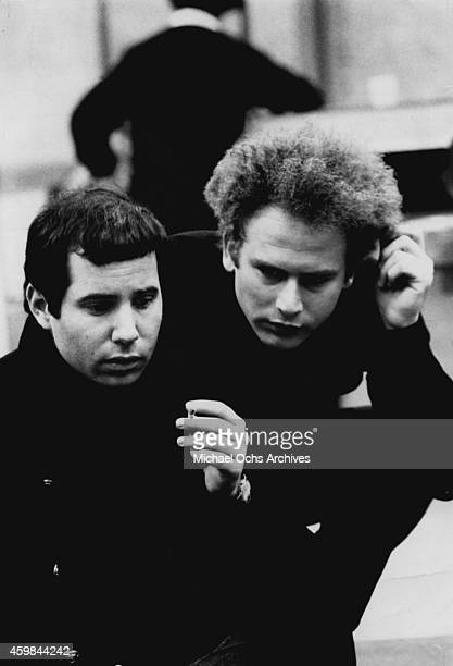 Singer/songwriter Paul Simon and singer Art Garfunkel of the folk rock duo Simon Garfunkel in a Columbia Records publicity still circa 1967 1966 in...