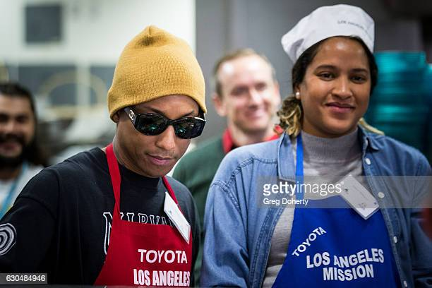 Singersongwriter Pharrell Williams and his wife Helen Lasichanh attend the Los Angeles Mission Christmas Celebration at Los Angeles Mission on...