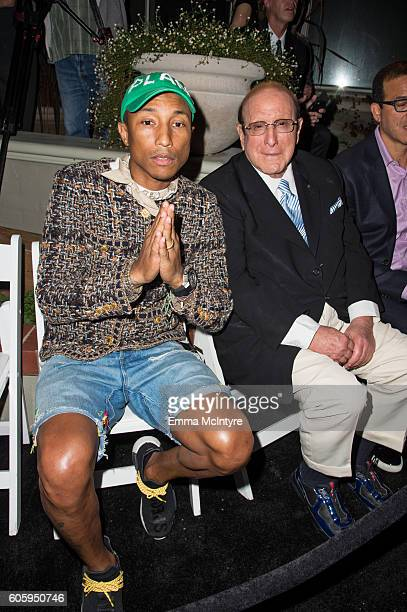 Singer/songwriter Pharrell Williams and record producer Clive Davis attend Songs Of Hope at a private residence on September 15 2016 in Brentwood...