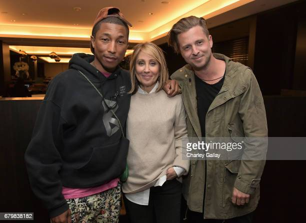 Singer/songwriter Pharrell Williams CEO of 20th Century Fox Stacey Snider and singer/songwriter Ryan Tedder at City Year Los Angeles Spring Break on...