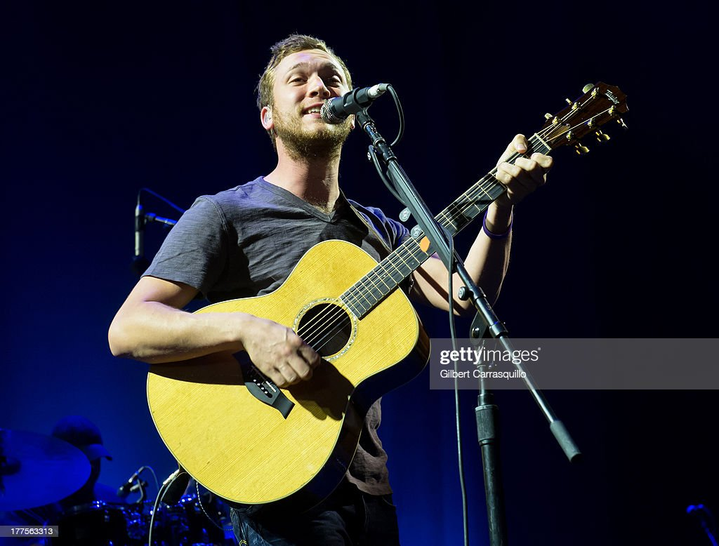 Singer-songwriter <a gi-track='captionPersonalityLinkClicked' href=/galleries/search?phrase=Phillip+Phillips&family=editorial&specificpeople=1651494 ng-click='$event.stopPropagation()'>Phillip Phillips</a> performs during John Mayer's Born and Raised World Tour 2013 at Susquehanna Bank Center on August 23, 2013 in Camden, New Jersey.