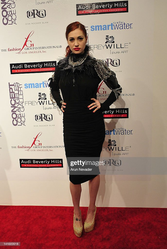 Singer/songwriter (muse to Amalia Mattaor) <a gi-track='captionPersonalityLinkClicked' href=/galleries/search?phrase=Porcelain+Black&family=editorial&specificpeople=7494640 ng-click='$event.stopPropagation()'>Porcelain Black</a> appears on the red carpet at 'Meet The Designer and the Muse' at Ace Gallery on March 8, 2012 in Los Angeles, California.