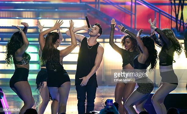 Singer/songwriter Prince Royce performs with dancers at the 2015 iHeartRadio Music Festival at MGM Grand Garden Arena on September 19 2015 in Las...