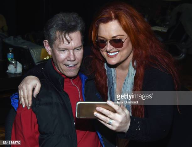 Singer/Songwriter Randy Travis and Wynonna Judd chat during 1 Night 1 Place 1 Time A Heroes Friends Tribute to Randy Travis Rehearsals on February 7...