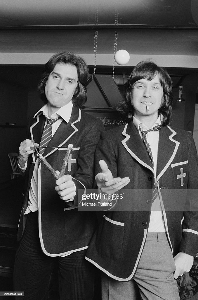 Singer-songwriter Ray Davies (left) and his brother, guitarist Dave Davies, of English pop group The Kinks, dressed as schoolboys, 20th January 1976. Ray is holding a catapult, while Dave is smoking a cigarette. They are promoting the album 'Schoolboys In Disgrace'.