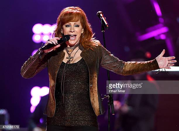 Singersongwriter Reba McEntire performs onstage during ACM Presents Superstar Duets at Globe Life Park in Arlington on April 17 2015 in Arlington...