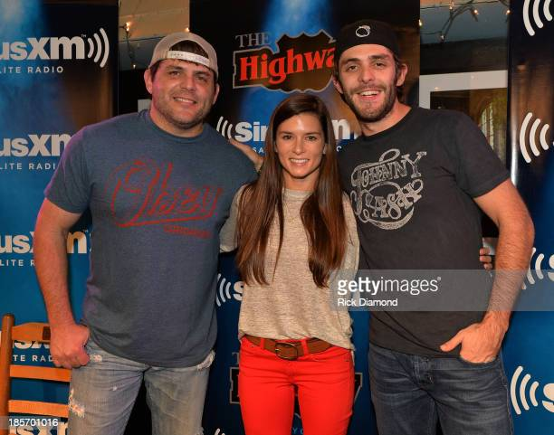 Singer/Songwriter Rhett Akins NASCAR Driver Danica Patrick and Singer/Songwriter Thomas Rhett pose after a taping of SiriusXM The Highway VIP...