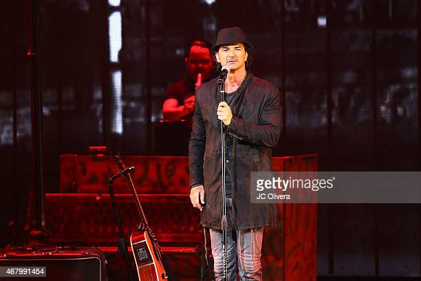 Singer/songwriter Ricardo Arjona performs on stage at Nokia Theatre LA Live on March 28 2015 in Los Angeles California