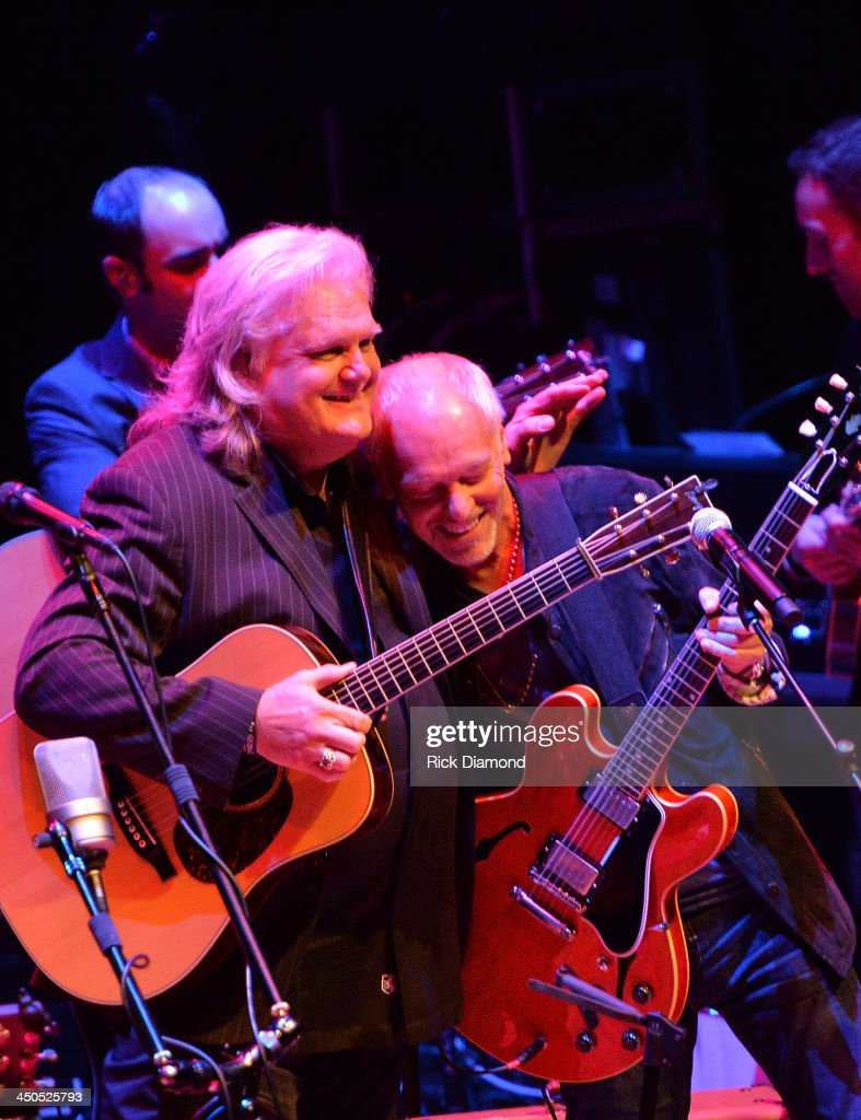 Singer/Songwriter <a gi-track='captionPersonalityLinkClicked' href=/galleries/search?phrase=Ricky+Skaggs&family=editorial&specificpeople=2134089 ng-click='$event.stopPropagation()'>Ricky Skaggs</a> and Singer/Songwriter<a gi-track='captionPersonalityLinkClicked' href=/galleries/search?phrase=Peter+Frampton&family=editorial&specificpeople=221428 ng-click='$event.stopPropagation()'>Peter Frampton</a> along with his band Kentucky Thunder perform at CMA Theater on November 18, 2013 in Nashville, Tennessee. Skaggs was recently announced as the Country Music Hall of Fame and Museum's 2013 Artist-in-Residence.